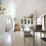 The distinctive gentle curves define the high ceilings in the villas