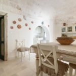 Whitewashed Salento stone and well chosen furnishings gives the villa a charming feel