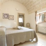 The villa's bedrooms feature the high, arched ceilings, distinctive of Puglia accommodation