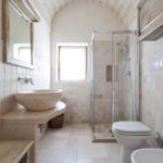Another spacious bathroom serves the second villa