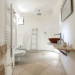 A modern bathroom complements the trullo