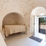 The accommodation inside the second trullo features quirky bed space