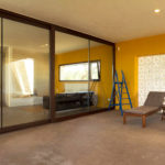 Full length windows lead onto an exterior sitting space