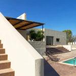 The stunning pool and minimalist exterior