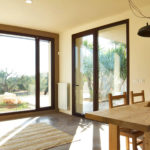 Full length retractable windows allow plenty of light into the living space