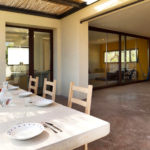 Outside dining area with view into the Villa
