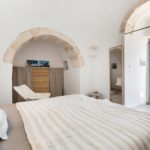 The exposed stone arches help give the classic trullo feel inside
