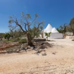 A private driveway leads to the trullo