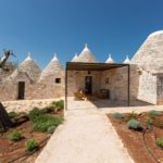 The beautiful, classic Trulli with white-tipped conical roofs