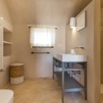 Spacious modern bathrooms - some with a rustic flavour