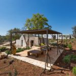 Picturesque Trulli accommodation at Villa Colomba, with additional outside shaded social area