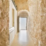 A bright hallway in traditional stone in one of the independent trullo buildings
