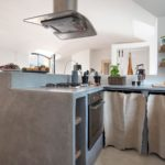 The polished concrete kitchen units with modern appliances