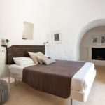 Despite trulli traditionally being rather small, this master trullo bedroom has plenty of space to spread out