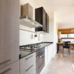 The kitchen in the first apartment is small but equipped with modern fittings, including dishwasher