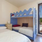The triple bedroom features a children's bunk bed and single