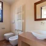 The shared bathroom comes with towel rack and modern fittings