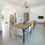 The open plan living space leads through into the kitchen