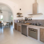 The kitchen is spacious and has a natural feel