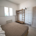 The room exudes natural simplicity and has ample storage