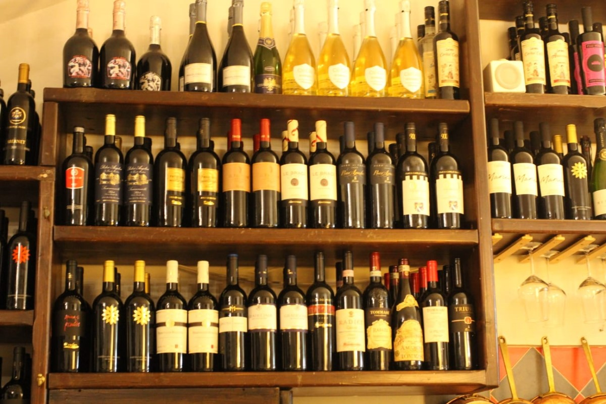 Restaurants and antipasti in Ceglie Messapica, choose a bottle of wine on holiday with Villa Rentals Puglia